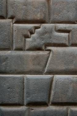 Inca's stone masonry: Part of a wall in near Macchu Picchu, Peru. Ancient architecture at its finest. No Mortar used to create these walls. Each stone fits so perfectly together that you cannot fit a piece of paper through a crack!