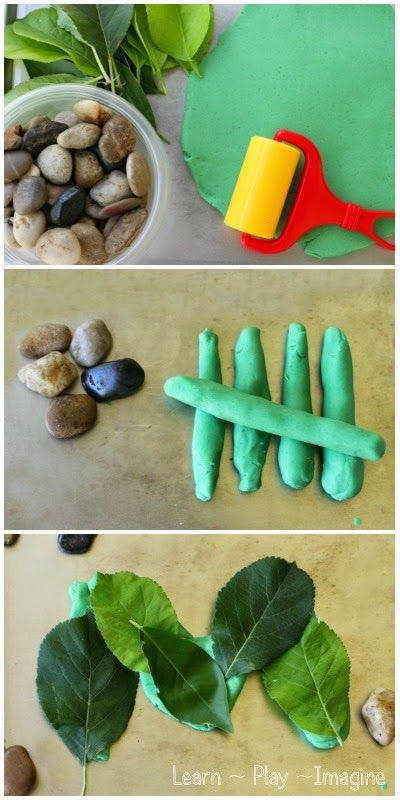 Playdough learning tray with rocks and leaves.  Open ended play based learning for preschool and kindergarten.