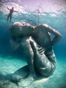 Installed in October 2014 in Nassau, Bahamas, Ocean Atlas references the ancient Greek sculpture of Titan Atlas. The sculpture, commissioned by the Bahamas Reef Environment Educational Foundation, is the largest single sculpture to be deployed underwater; it reaches from the sea floor 5m up to the surface and weighs over 60 tonnes. It creates an artificial reef for marine life to colonise and inhabit. By Jason deCaires Taylor, www.jasondecairestaylor.com