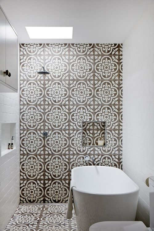 What a great tile statement in a small space! Walker Zanger