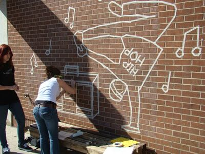 Masking Tape Murals: Name a topic that is important to being a teenager in high school, form teams based on the topics selected and create sketches based on those ideas and create a mural using only masking tape.
