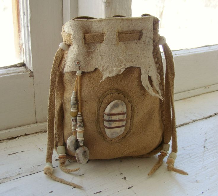 BUCKSKIN BILL deerskin Medicine Bag Spirit Pouch with deer antler and antique trade beads. $72.00, via Etsy.
