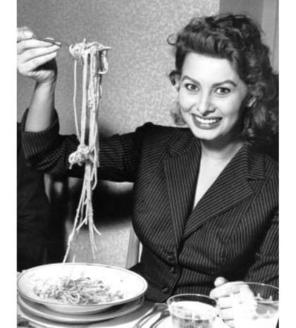 Sophia Loren enjoying delicious pasta! A woman after my own heart!