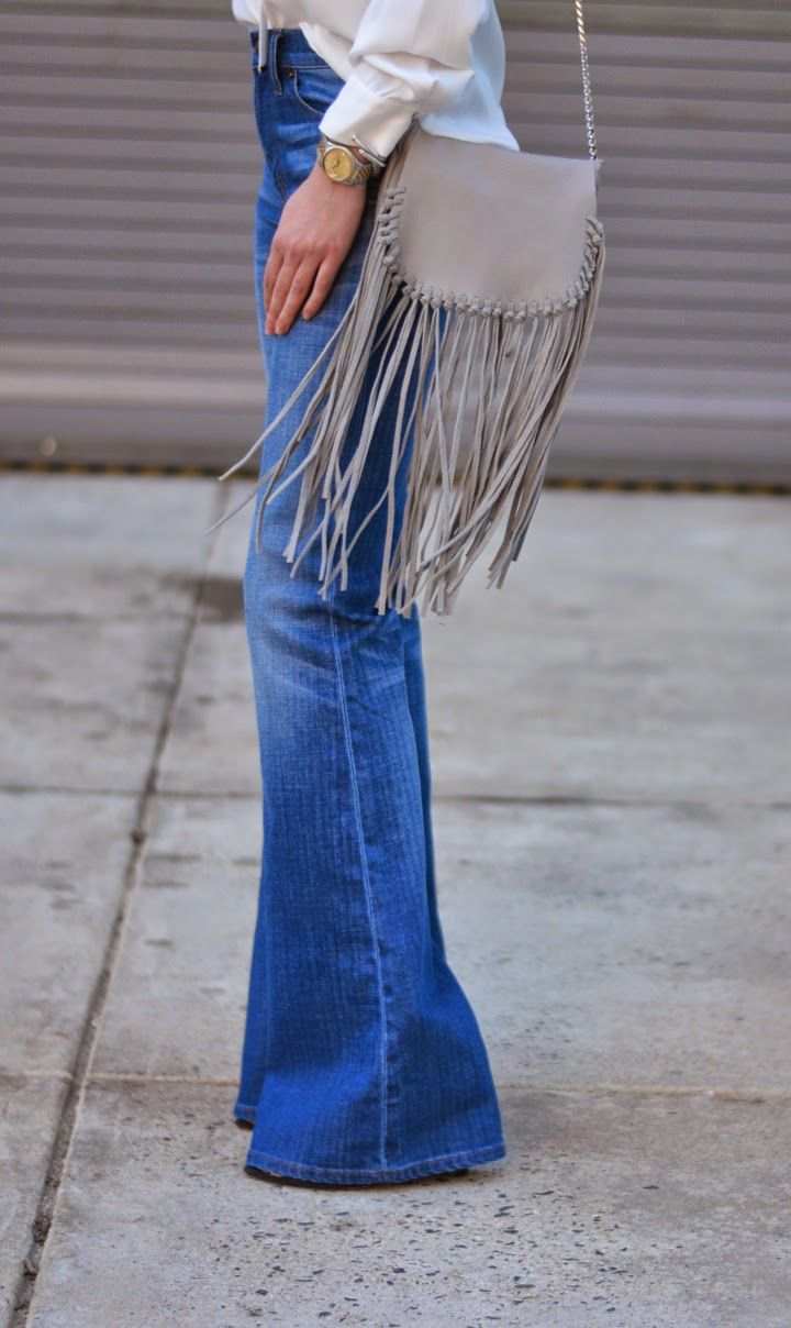 Flared denim + fringe bag.