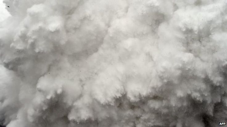 An avalanche was captured on camera moments before it descended on Everest Base Camp.  A cloud of snow and debris triggered by an earthquake flies towards Everest Base Camp, moments before parts of the camp were flattened, in the Himalayas, Nepal, on April 25, 2015.  Roberto Schmidt-AFP/Getty Images