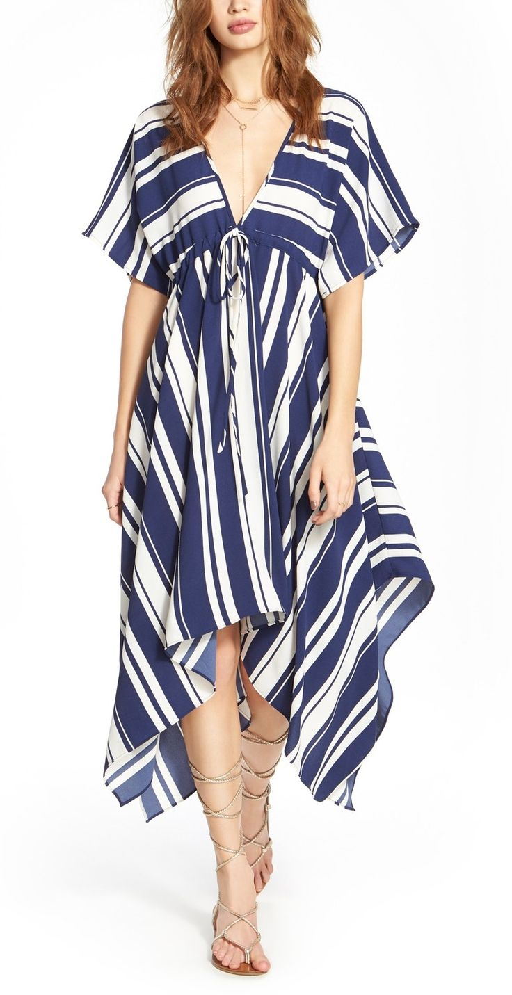 In love with this striped, flowy dress from Roxberi Elle! It features a plunging V-neckline and short kimono sleeves for an intriguing look.