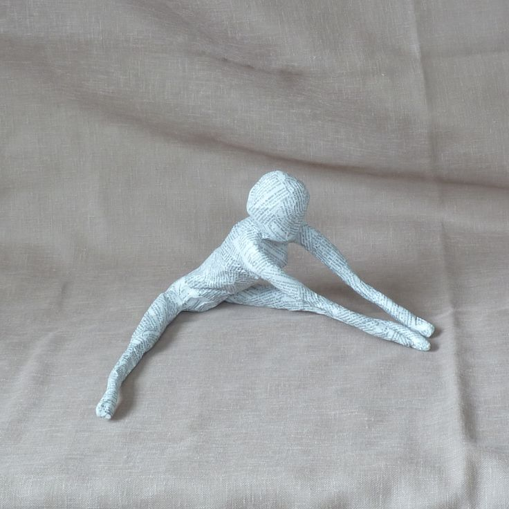 forward bend yoga pose paper mach figure