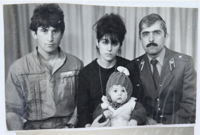 ''A photo showing #TamerlanTsarnaev (center, bottom - the baby!) accompanied by his father #Anzor (left), mother #Zubeidat, and uncle #Muhamad Suleimanov (right), is seen courtesy of the #Suleimanova family in #Makhachkala. (#Reuters)'' #Chechen #Chechnya #BostonMarathon #Russia #Russian #CentralAsia #babies #baby