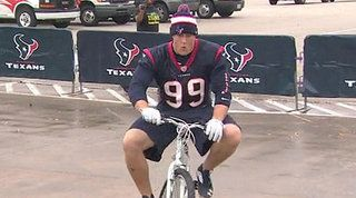 Texans players play Santa with bike giveaway