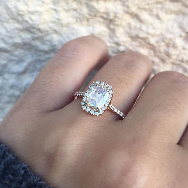 This Henri Daussi rose gold engagement ring with a light L colored diamond is one of a kind.