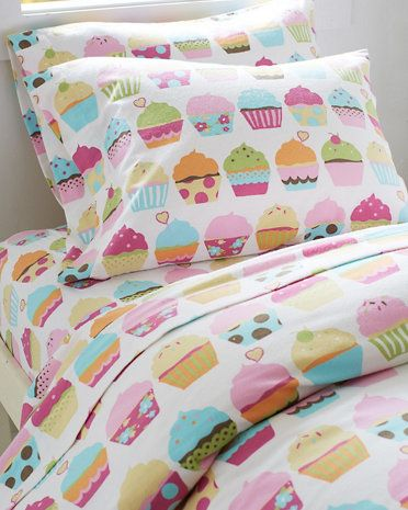 Let's admit it, sometimes bedtime isn't so fun -- but it can be. These supersoft cotton flannel sheets sweeten the deal with stacks of decked-out cupcakes.