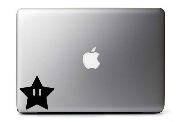 Mario Star Inspired Die Cut Vinyl Decal for MacBook / Laptop / Cars & More!  Pictured: -Black, demonstrated on a 13 MacBook  Die cut. Sandwiched between