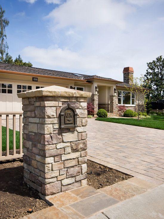 Stone pillar mailbox with sloping capstone