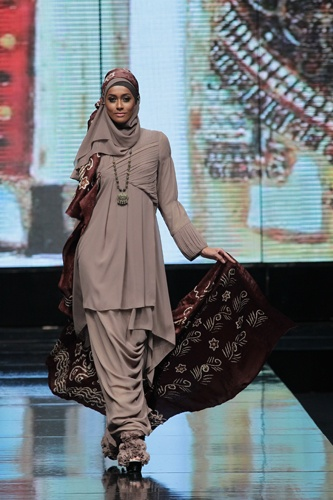 Perfectly tailored taupe dress from Jakarta Fashion Week