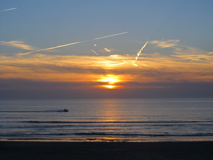 A Jetski passed by as the sun starts to set