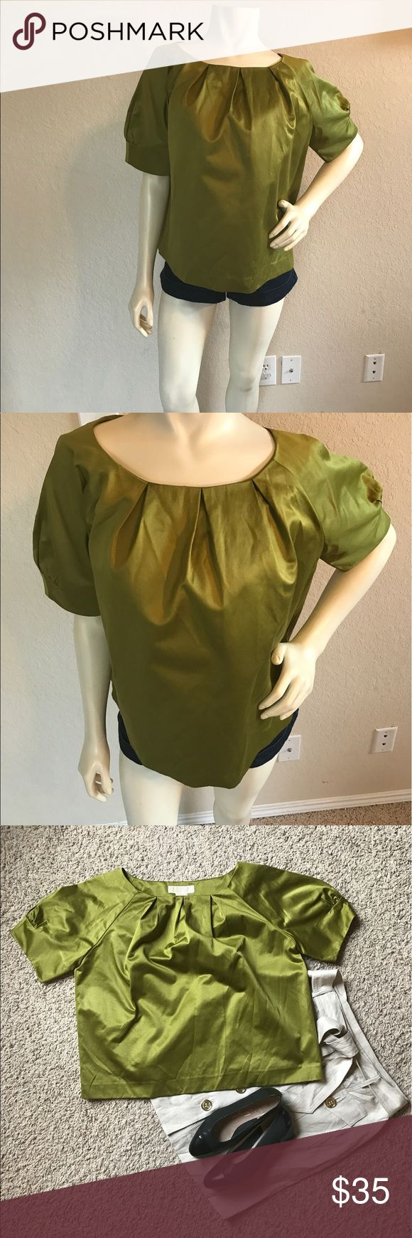 "Michael Kors Green Short Sleeve Top Size M Michael Kors Green Short Sleeve too, Size Medium.   This top has a thick satin fill but is cotton and Polyester blend. Top looks classy and perfect for work.   MEASUREMENTS:  Bust: 23"" Length: 22"" MICHAEL Michael Kors Tops Blouses"