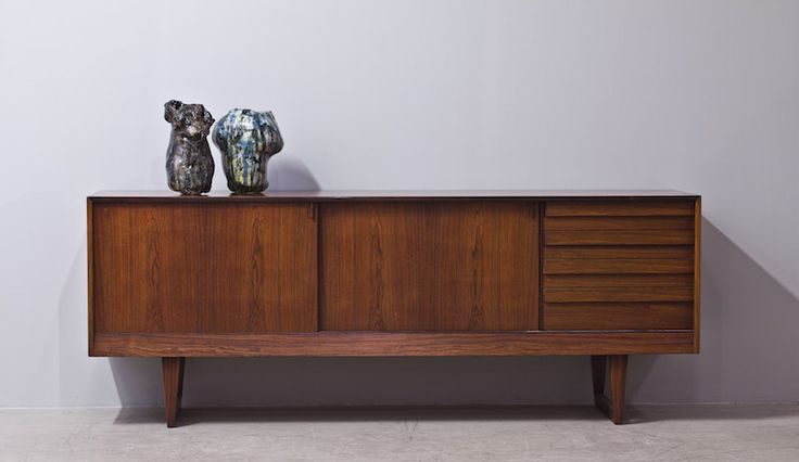 Vintage rosewood sideboard with sliding doors and four drawers with beautiful details inside. Mid century. Danish.