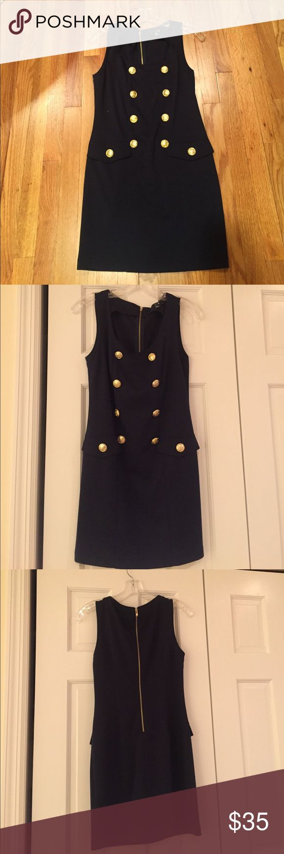 Forever 21 Navy Blue Dress - Size M Item Description: Comfy and chic dress! Worn several times but in great condition! Navy dress with gold nautical themed buttons. Women's M from Forever 21  Shop Details: Smoke free and pet free household. Willing to accept your best offer! Please comment if you have any questions and I will get back to you within 24 hours. Forever 21 Dresses Midi