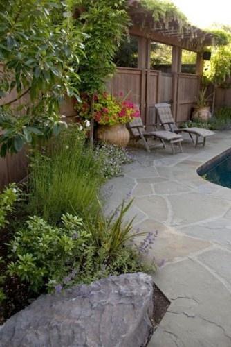 Fence around pool. Love the stones around the pool instead of plain concrete