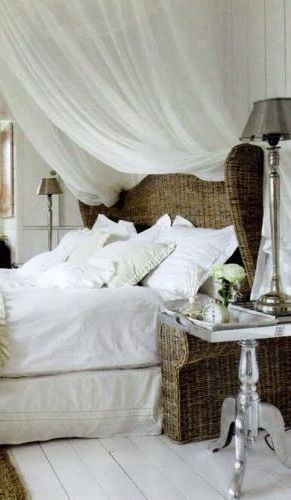 love the sheer canopy and wicker