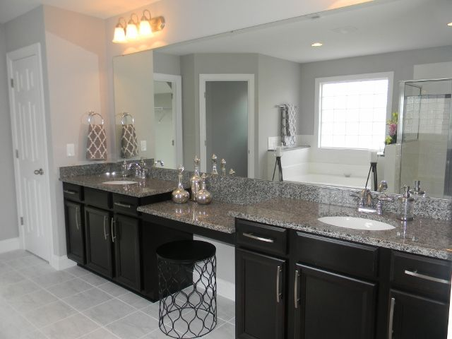 Timberlake Tahoe Maple Espresso Cabinets with dual vanity and knee space. New Caledonia 3cm Granite.
