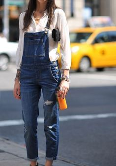 Overalls and a white shirt.