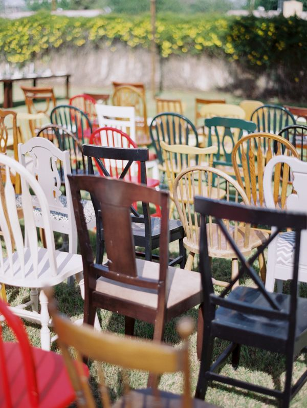 mismatched ceremony chairs - photo by Rachel Solomon Photography http://ruffledblog.com/handcrafted-mismatched-backyard-wedding