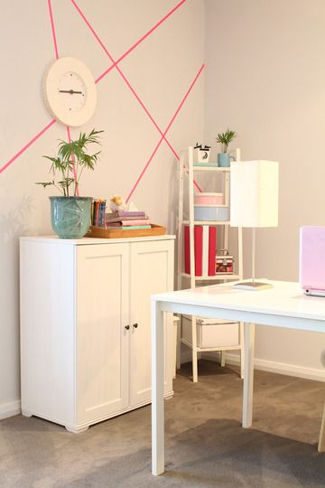 Use Washi tape to create pattern on your walls. Bonus, it's removable. Great for renters!