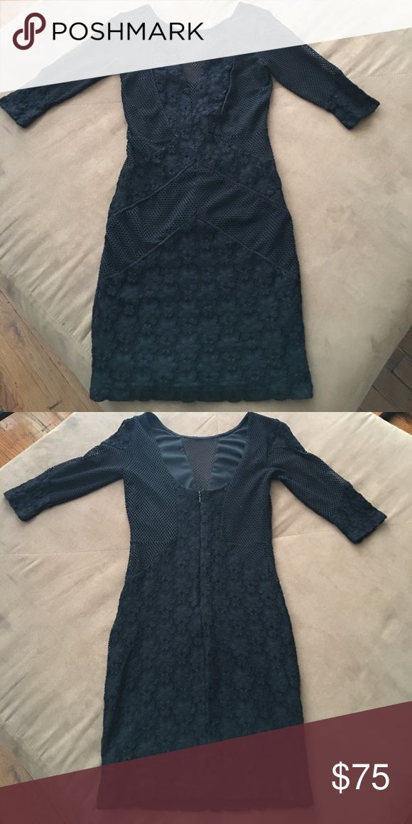 Black bodycon dress with 3/4 sleeve Barely used and in great condition! The material incorporates fish netting and flower lacing. The neck line is a deep v with netting covering the v up to the neck Topshop Dresses Mini