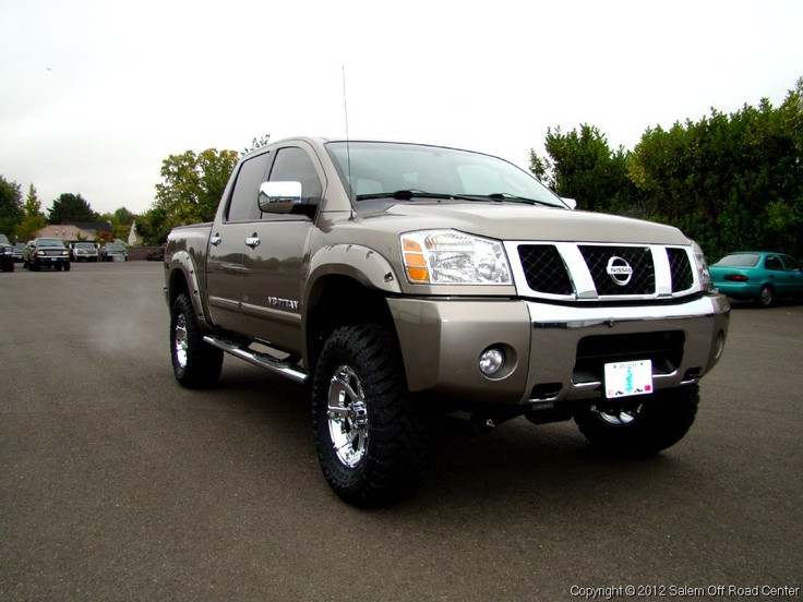 """A 2007 Nissan Titan with a Fabtech 6"""" lift with Dirt logic coilovers in the front and Dirt logic shocks in the rear. Also painted to match Bushwacker pocket style flares! http://www.salemoffroadcenter.com/"""