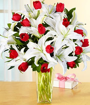 http://www.beautiful-flowers.org -   #Red #tulips & #white #oriental #lilies – #Deluxe #Bouquet. Item Description:    5 stems of white oriental lilies (multiple blooms)  15 red tulips  5 ruscus  Item #30057763    Fall in love all over again this holiday #season. This #amazing bouquet of crisp white lilies and deep red tulips, as #beautiful as the day you first met, is the perfection expression of love and devotion.