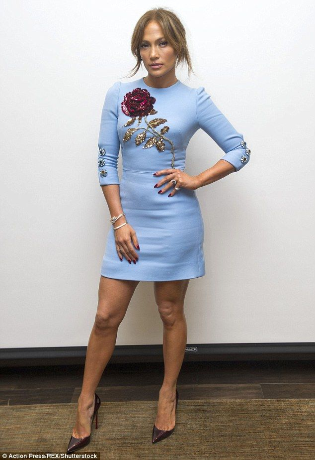 Just one shade of blue: Jennifer Lopez shows off her trim figure in a powder blue mini dress as a photocall for her TV show Shades Of Blue
