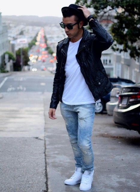 Choose a black leather moto jacket and baby blue jeans for a refined yet off-duty ensemble. Dress down this getup with white high top sneakers. Shop this look for $145: http://lookastic.com/men/looks/biker-jacket-crew-neck-t-shirt-jeans-high-top-sneakers-hat-sunglasses/6389 — Black Leather Biker Jacket — White Crew-neck T-shirt — Light Blue Jeans — White High Top Sneakers — Black Wool Hat — Black Sunglasses