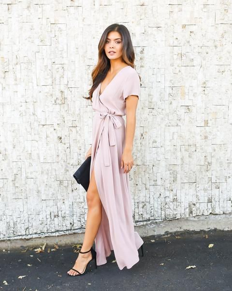 This is an example of the wrap style dress. The wrap style is very flattering and can be worn for any occasion. The wrap dress features a slit, a definite waistline, and a deep V neckline.