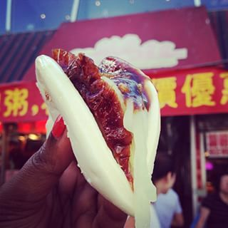 Peking Duck Bun at Corner 28 |Corner 28 in Flushing is a whole restaurant, but what you want is the $1 Peking Duck bun from the stall outside 39 Delicious New York City Foods That Deserve More Hype