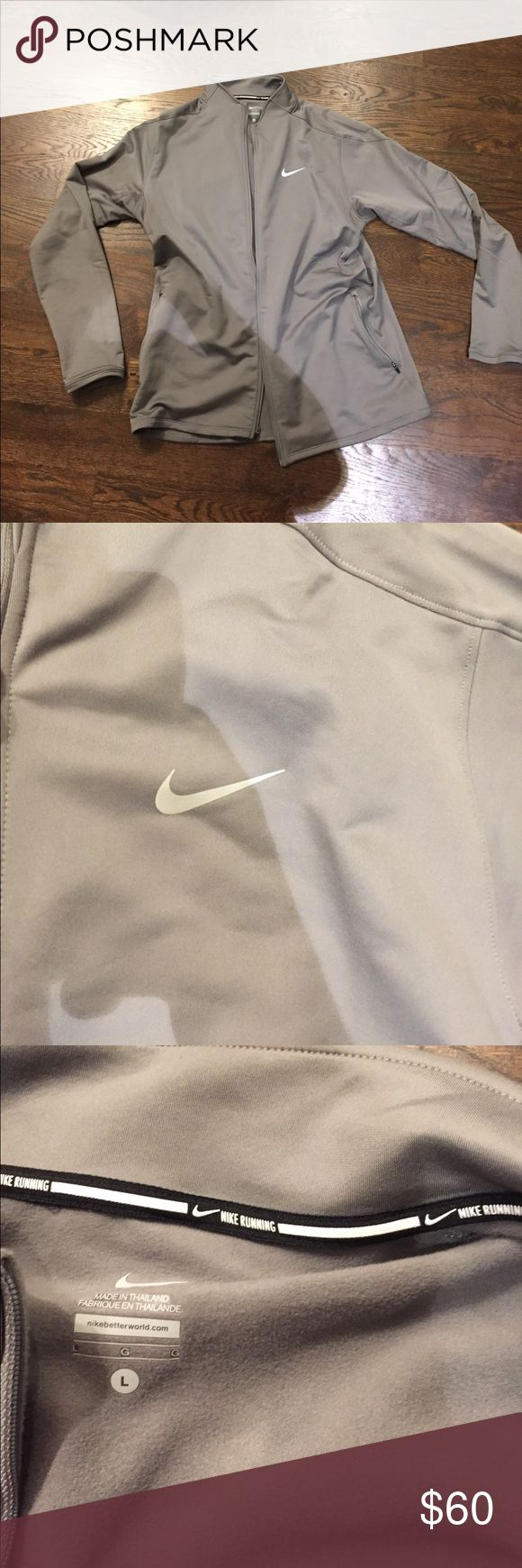 Men's Nike running jacket The zipper is broken on the bottom(pictured above) but seems like an easy fix, the jacket is great for running in the fall weather or whenever there is a breeze Nike Jackets & Coats Performance Jackets