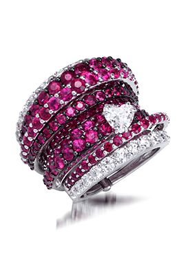 An 18K white gold ring, set with diamonds, rubies and a heart-shaped diamond, by Stefan Hafner.
