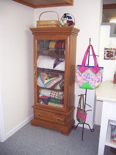 Gun cabinet for quilts.   Why didn't I think of that!!!!!