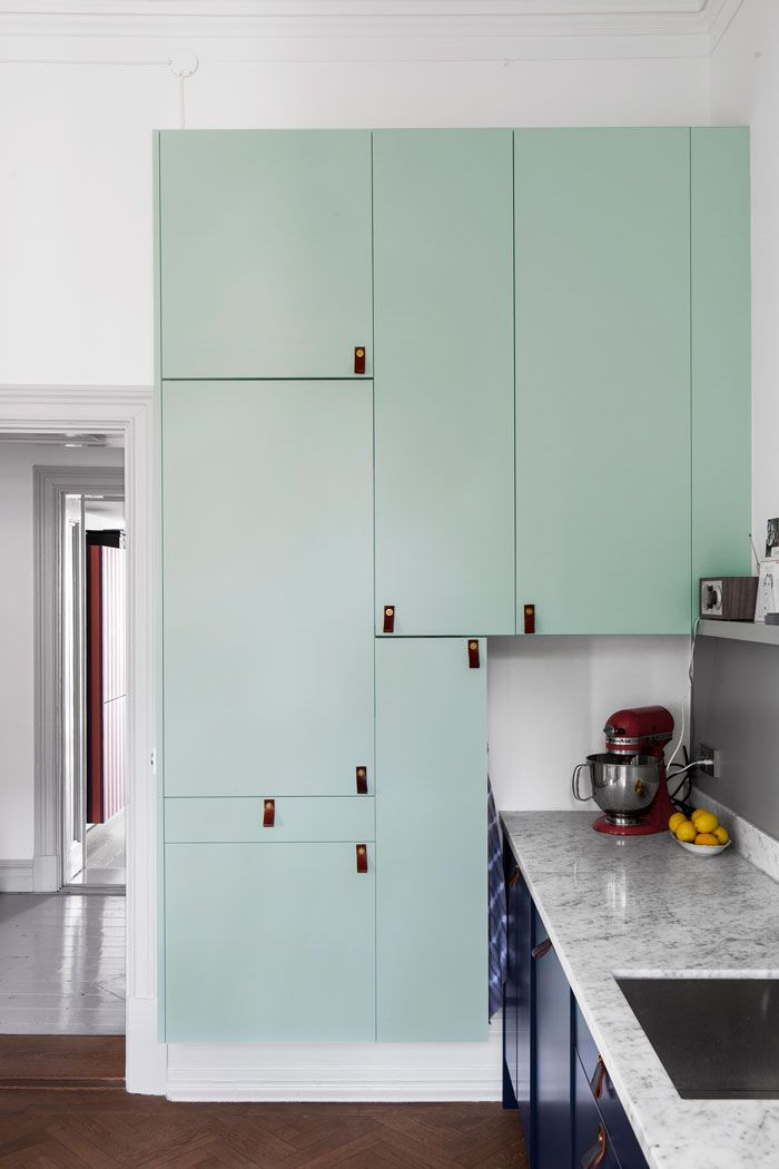 Beautiful mint color used on kitchen cabinets along with leather pulls | Entrance