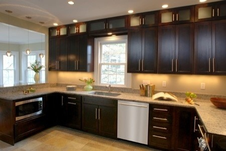 Dark cabinets with a light tile floor. I like the microwave installed on the bottom. More discreet and would make it easier for the kiddos to be independent. Guess it could go along with the mini trudge in the island idea.