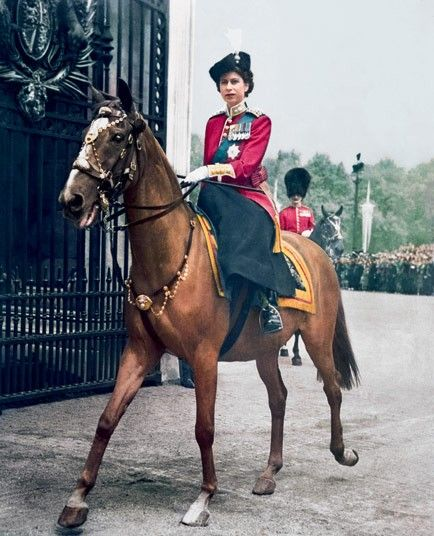 Princess Elizabeth rides through the Centre Gate at Buckingham Palace having represented her sick father King George VI at Trooping the Colour in London on June 7, 1951.