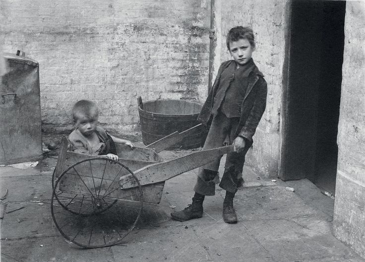 Barrow boys: Tommy Nail pushes one of his brothers in a make-shift wheelbarrow in the 1890s. The boys' mother died two years later, her death certificate starkly citing the cause as 'exhaustion'