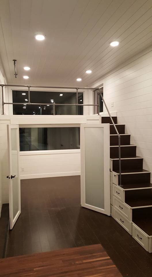 Double French Doors Provide Privacy For The Main Floor Master Bedroom Tiny House Interior Design Tiny House Living Room Tiny House Interior