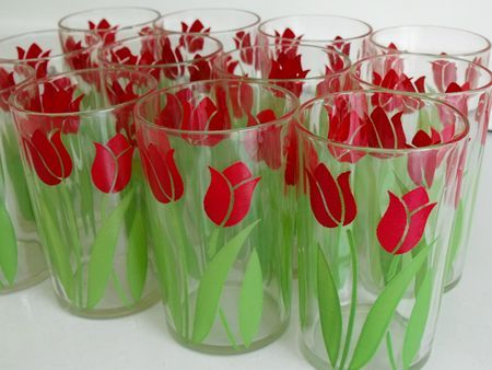 Swanky Swigs juice glasses with red tulips.  Come out to Jeffrey's Antique Gallery in Findlay, Ohio and see our huge selection of glassware.  Follow Jeffrey's Antique Gallery in Facebook, too! www.jeffreysantique.com