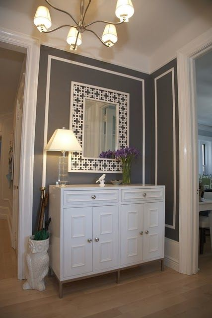 Entry idea, white chest for storage, mirror to expand space, rich grey to pull out of granite color and mix with stainless in kitchen.