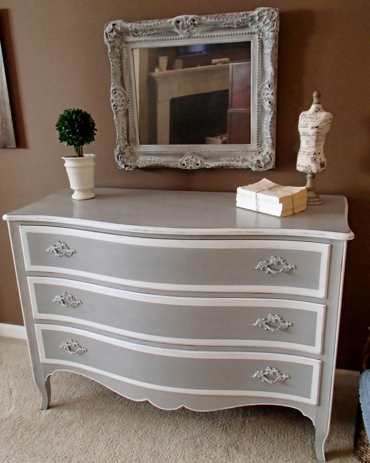 I painted in Annie Sloan's Paris Grey and Pure White and sealed with clear wax.  I went over the pulls lightly with Pure White and sealed wi...