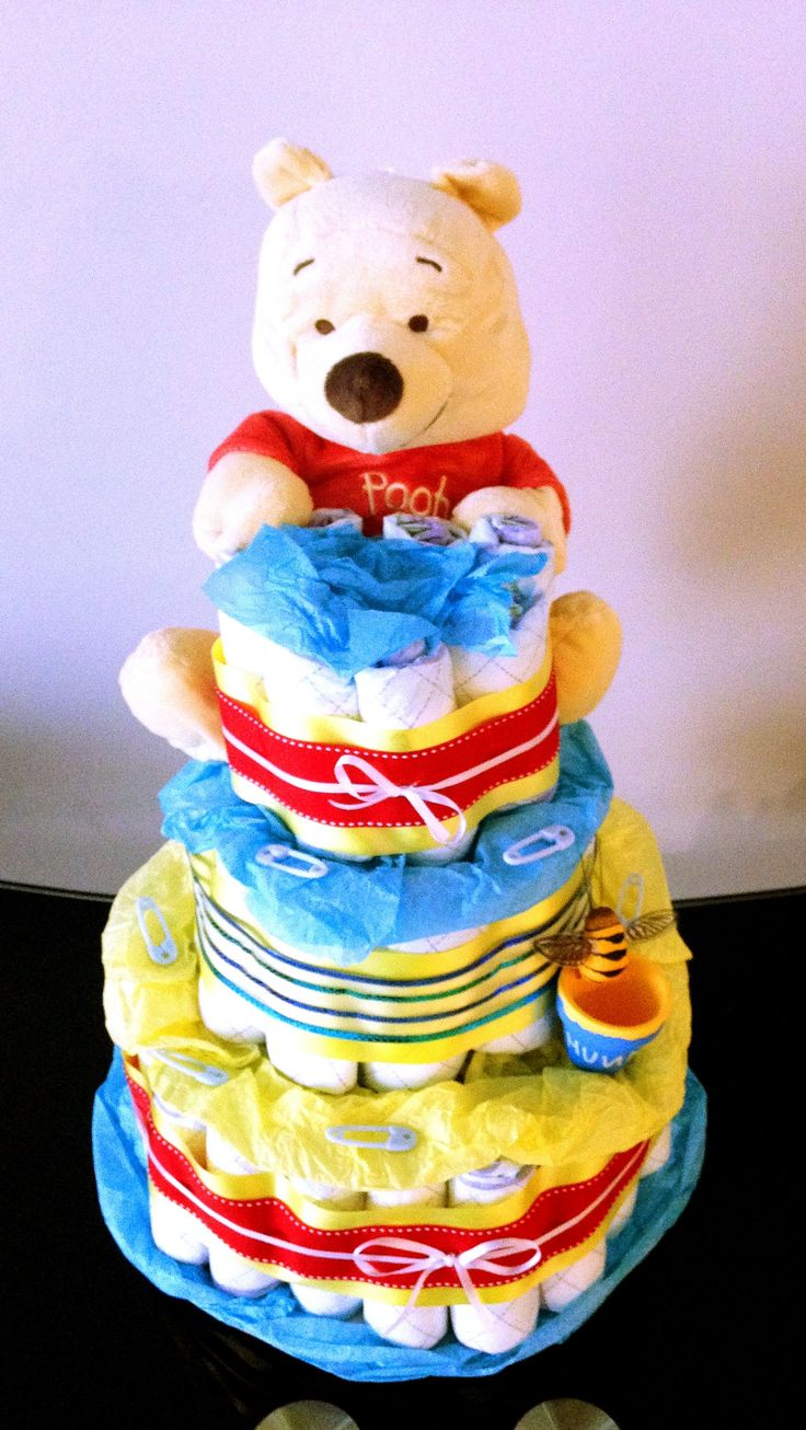 """- 3 tier diaper cake decorated with baby binki and clothespin props, tissue paper and decorative ribbon - Nursery/babyshower themed stuffed animals to decorate """"cake"""" - Every diaper is 100% useable, n"""