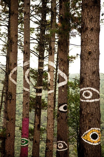 We could do this with moss instead og paint, make a mixture of moss, yoghurt and beer and paint motives on trunks of trees
