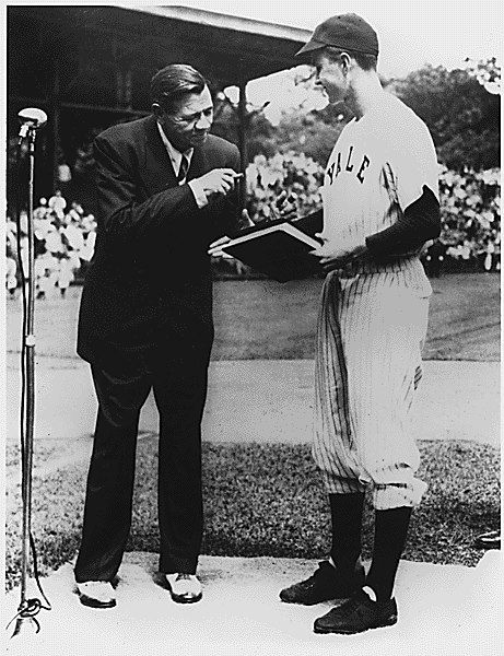 Babe Ruth in 1948, donating the manuscript of his autobiography to Yale. The young man in uniform is captain of the Yale baseball team and future president George Herbert Walker Bush- he is an older college student who had delayed going to college to join the Navy after the attack on Pearl Harbor.
