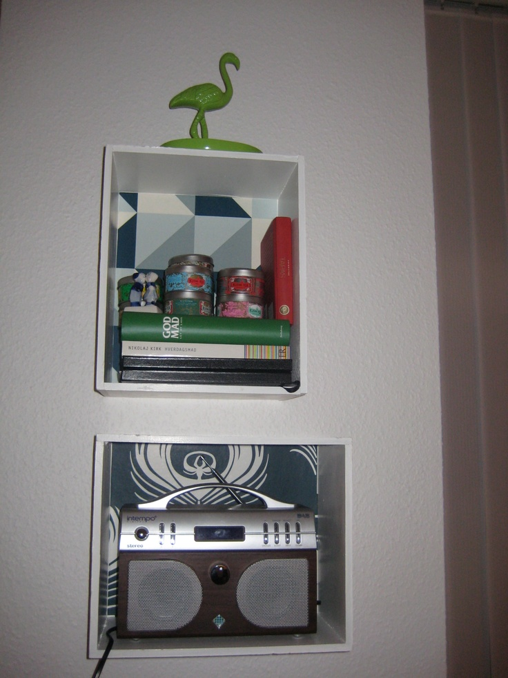 Shelves with wallpaper, made from wine boxes
